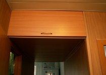 Навесные мебельные антресоли на кухню уголком